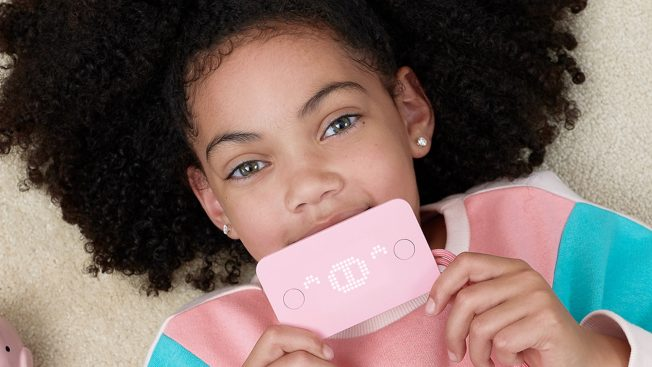 Young girl holding pink Pigzbe Crypto Storage Wallet